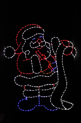 Red, white and blue LED display of Santa checking his list