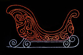 Large beautiful sleigh made up of red LED lights with a white bottom