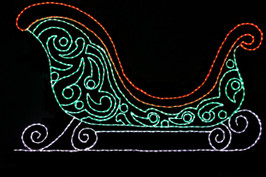 Beautiful large LED light display of a green Christmas sleigh with red trim and a white bottom
