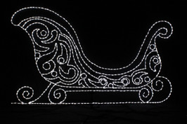 Large beautiful sleigh made up of white LED lights forming a swirly elegant design