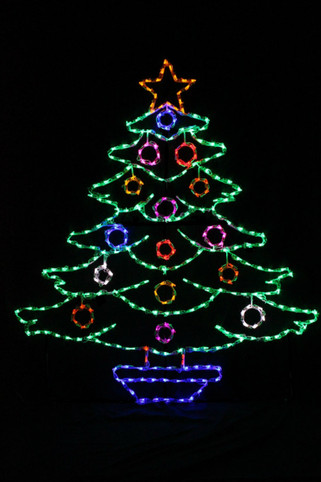 Large decorated  green LED light Christmas tree with red, white, and blue ornaments and a star on top