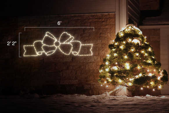 """LED light display of a beautiful flowing warm white bow with dimensions 6' by 2'2"""""""