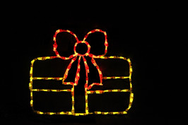 LED light display of a yellow Christmas package with a red ribbon