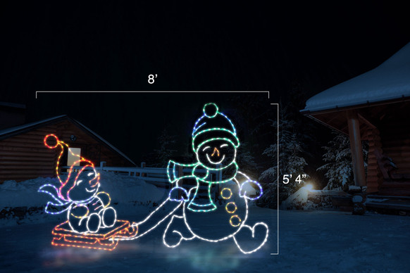 Two LED snowmen adorn in colorful hats, scarves and mittens; one snowman is pulling the other on a red sleigh with dimensions 8' by 5'4""