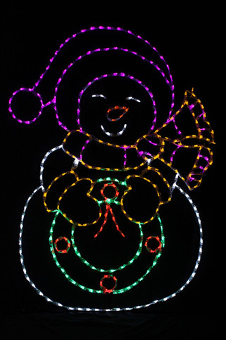LED light display of a snow lady with a yellow scarf and mittens, a purple hat, who is holding a green wreathe with a red bow and berries