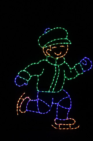 LED light display of a blue and green boy ice skating