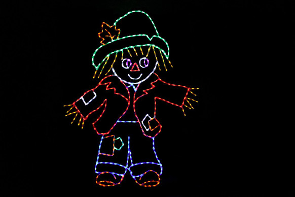 Green, red and blue LED light display of a scarecrow