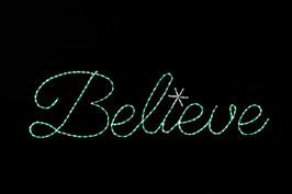 "Green LED lights sign saying ""Believe"""