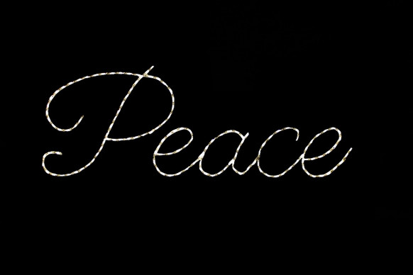 White LED light display of the word peace