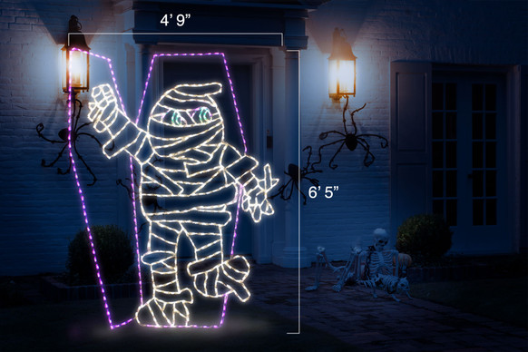 "Animated LED white mummy coming out of a purple coffin with dimensions 4'9"" by 6'5"""