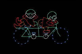 Animated red and green LED light display of two elves riding a bike