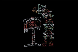 "Animated LED sign of four green and red elves stacked on top of one another hammering a red and white ""North Pole"" sign into the ground"