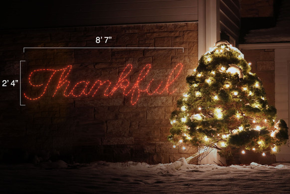 """LED light display of a sign saying """"Thankful"""" with dimensions 8'7"""" by 2'4"""""""