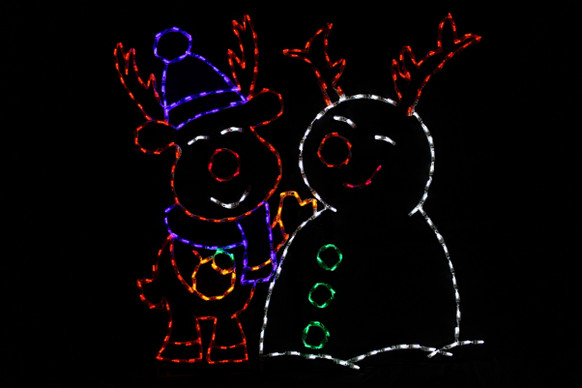 LED light display of a red and purple reindeer building a white snowman with green buttons and red antlers