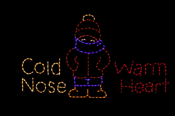 "LED sign saying ""Cold Nose Warm Heart"" with a bundled up child in the middle"