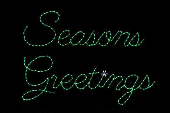 "Green LED light display of a sign saying ""Seasons Greetings"""