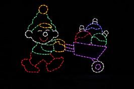 Elf rolling a wheelbarrow of ornaments outdoor Christmas decoration