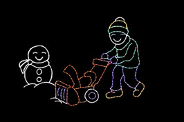 Person pushing snowblower in front of a snowman outdoor light up decoration