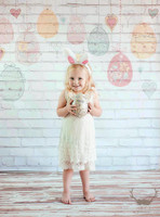 Hanging Easter Eggs on White Brick Backdrop - Item 1845