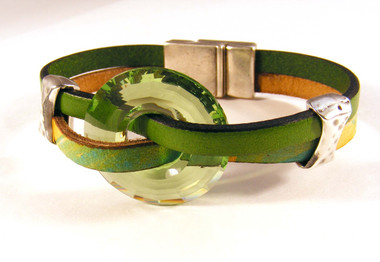 Captured Disk - Peridot disk with Green and Orange Multi leather strips and Hammered Bow Tie sliders