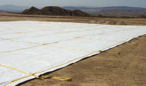 6.6 oz. 14 mil White/Black Polyethylene Landfill Covers