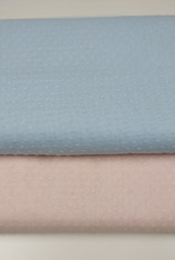 Swiss plumetis fabric.  In a beautiful an ever so pretty soft peachy pink or baby blue with self coloured cut spot, 100% cotton, 140 cm wide Will make up into all sorts of outfits, Washable at 30 degrees, Priced per metre
