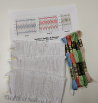 Kit includes, Robbie's Bubbles and Bonnets Smocking Plate by Ellen McCarn, Three pre-pleated fabric pieces,  Five DMC threads, No 7 crewel needle