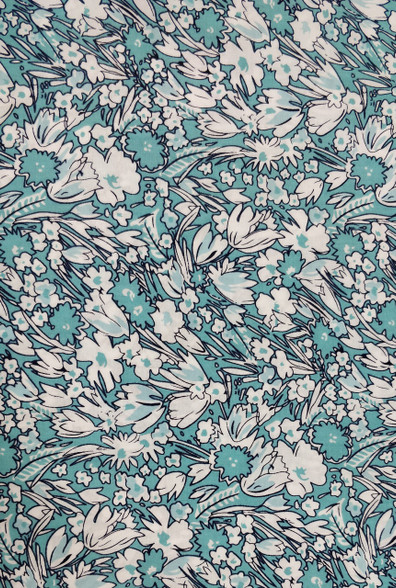 A beautiful green and white floral cotton fabric   Would look superb made into dresses or blouses,  Would work well with white imperial broadcloth smocked insert,  144cm wide,  Wash at 30 degrees,  Priced per metre,  Telephone for part metres