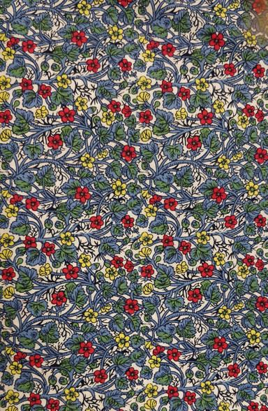 A lovely blue floral cotton fabric with red roses  Would look fabulous made into dresses or blouses  Would work well with white imperial Broadcloth smocked insert,  144cm wide,  Wash at 30 degrees,  Priced per metre,  Telephone for part metres