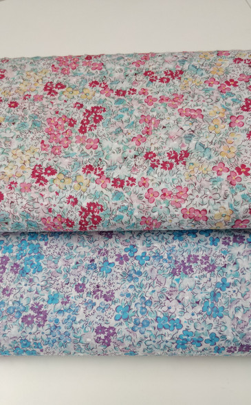 A really pretty soft fabric with a tiny cut spot, available in pink or blue floral design, 100% cotton, 148 cm wide, wash at 30 degrees, Priced per metre