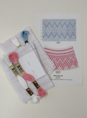 Ready to smock kit with two designs, Kit includes, Prince and Princess Smocking Plate by Ellen McCarn, Two pre-pleated inserts one for each design, Four DMC threads, No 7 crewel needle