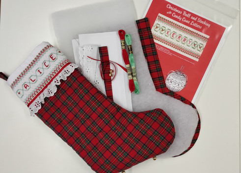 Ready to Smock Christmas stocking kit, Kit includes, Pattern by Ellen McCarn, Pre-pleated insert, Cut out pieces for the stocking, the linings and wadding, Embroidered trim, DMC x 2, Ribbon, Bells, Additional Step by step instructions