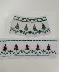 Christmas Trees Smocking plate by Ellen McCarn, A ready smocked insert Using the Smocking Plate Christmas Trees, Pleated and smocked on the full width of white imperial broadcloth, Insert is 26 cm from smocked edge to smocked edge but can be spread a little, Smocked in two colours red and green, Full depth of fabric is 9 cm
