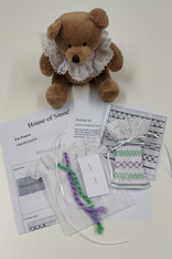 Complete Beginners Smocking kit, Smock this lace edged pot pourri or sweetie bag, Kit includes, Laced edged pleated fabric, DMC threads in green and purple, Ribbon, Crewel needle, Smocking design, Stitch instructions, Smocking tips, See attached video for help with the stitches
