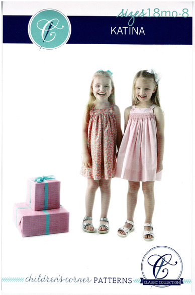 Katina is a classic sundress with straps that button onto the front yoke. The yokes are lined. Both skirts can be gathered or smocked for a breezy and easy to wear dress. Underarms are finished with a bias band. Sizes 18 month - 8 years, Smocking design included Please order size H silver dots if smocking