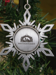 "Handcrafted, flat, solid Pewter Holiday ornament with antique finish and matching cord, featuring the perfect snowflake  and  The Arch– approx.. 2.5""x2.5"""