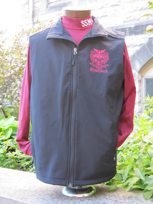 100% polyester woven shell bonded to a water-resistant film insert and a 100% polyester microfleece lining. Zip-through cadet collar with chin guard, front zippered pockets, open hem.  Black with embroidered Shattuck Eagle Crest image
