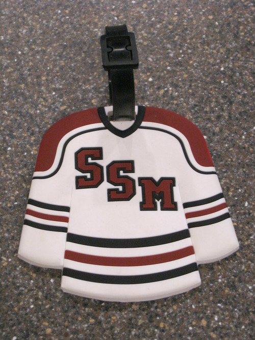 Sure to stand out in the luggage carousel!  Your very own hockey jersey luggage tag measures 3 3/4 x 3 1/2 inches.  Space for name, address and telephone number on the back.