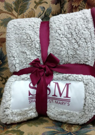 The frosty tipped, high-pile Sherpa material will keep you warm all winter long. The maroon thick color trim and woven patch make for a unique, understated design to show your school affinity.   Added bonus: Comes packaged folded and tied with a team color ribbon and bow. Makes a great gift!
