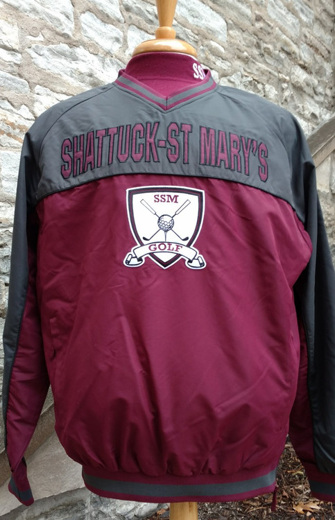 Shattuck - St. Mary's Golf Windbreaker. 100% Polyester, side zipper opening.  Maroon and charcoal, appliqued logos.