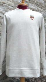 Men's  Wheat modern V-neck sweater. 65% Cotton/35% polyester. High density print brand on sleeve, embroidered stacked Shield logo. Regular fit.