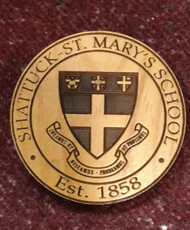 Round coaster set of 4 produced from Alder wood and detailed with laser etching of our school crest.  3.5 inch diameter.