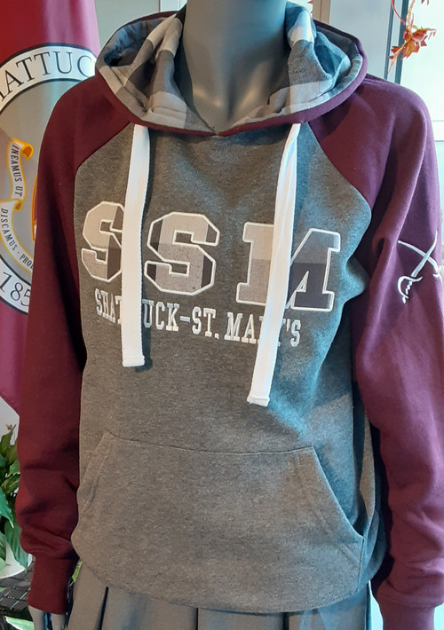 Just add a cup of hot cocoa with this sweatshirt.  Heather charcoal body with maroon raglan sleeves.  Black and white plaid hood lining and decoration on center chest.  Screened crossed sabres on left shoulder. Flat drawcords, kangaroo pockets.