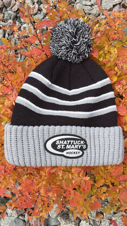 100% acrylic construction is lightweight, soft and warm with a wool-like feel.  Custom hockey patch and the three-stripe design and pom add some complementary color to this on-trend style.