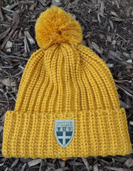 Sure to keep you toasty warm!  Wheat, chunk knit, pom cuffed hat with leather stacked Shield patch.