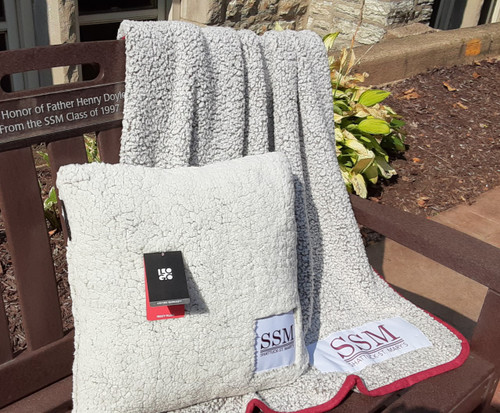 """Just in time for the cooler weather the Frosty Fleece Pillow.  Measuring 16"""" x 16"""", made of frosty tipped high-pile Sherpa material in a neutral color with a square SSM patch embellishment.  The zippered cover is removable for washing.  Pairs nicely with the Frosty Fleece Blanket!!!"""