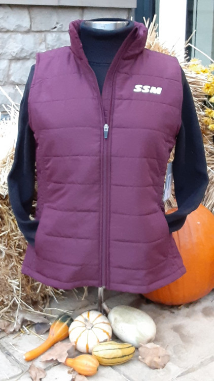 When the weather turns chilly, reach for the Colosseum Women's String Vest. This Shattuck - St. Mary's jacket is a great way to show your loyalty through changing temperatures. With SSM graphics and colors, this jacket is a perfect layer for game days or any day! Stay warm and share your team pride wherever you go.  -100% Polyester, screen printed graphics, full zip front, zippered side pockets.  Packable, pouch included.