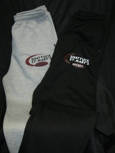 Sweatpants with screened hockey swoosh logo.  Features side pockets and open bottom hem.
