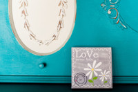Love Never Fails - Gray with Daisy 5x5 Cafe Mount