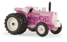 1:64 Pink Oliver 1950T diesel tractor with dual rear wheels and front wheel assist